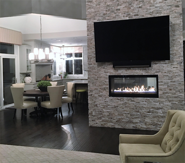 custom see-through fireplace brick wall
